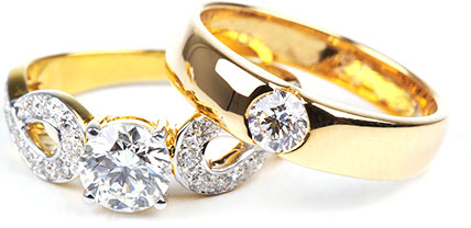 Two golden engagement rings with inset diamonds